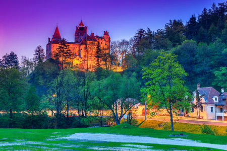 castle buildings: The famous Bran castle with stunning lights in the evening,Transylvania,Romania