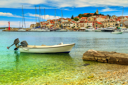 Dalmatian town with harbor and motorboat,Primosten,Croatia,Europe