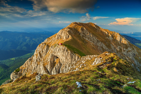 ridges: Beautiful sunset and narrow ridges in the Piatra Craiului mountains with a red refuge,Carpathians,Transylvania,Romania,Europe