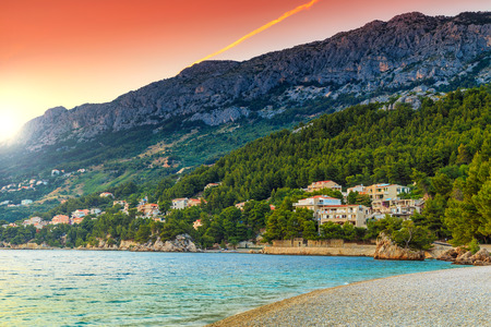 croatia: Beautiful gravel beach with high mountains on background and stunning sunset,Brela,Makarska riviera,Dalmatia,Croatia,Europe