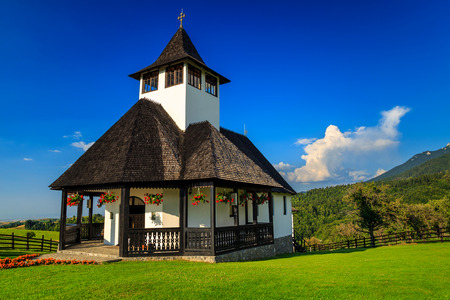 nature green: Traditional easy mountain Monastery with red geraniums,Bran,Transylvania,Romania,Europe