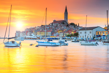 croatia: Wonderful romantic old town of Rovinj and famous fishing harbor with magical sunset,Istrian Peninsula,Croatia,Europe