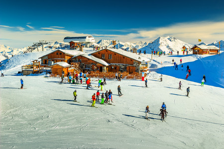 snow ski: Wooden chalets and ski slopes in the French Alps,Les 3 Vallees,Menuires,France,Europe