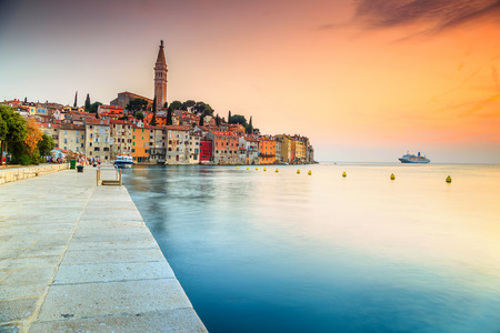 croatia: Famous romantic promenade with beautiful old town of Rovinj and magical sunset,Istrian Peninsula,Croatia,Europe