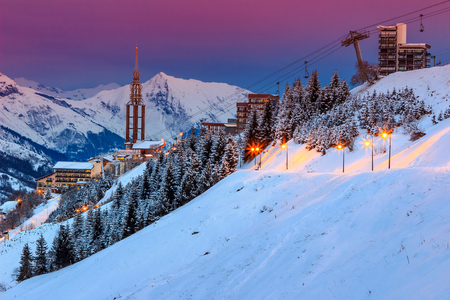 france: Majestic winter sunrise landscape and ski resort with street lights in French Alps Les Menuires,3 Vallees,France,Europe