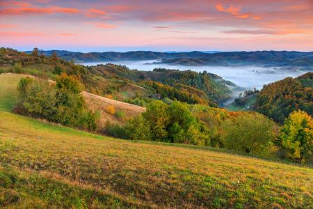 transylvania: Stunning autumn landscape with misty valley,Holbav village,Carpathians,Transylvania,Romania,Europe
