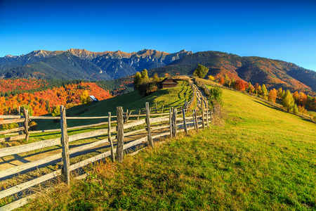 Colorful autumn alpine landscape with green fields and high mountains,Bran,Transylvania,Romania,Europe