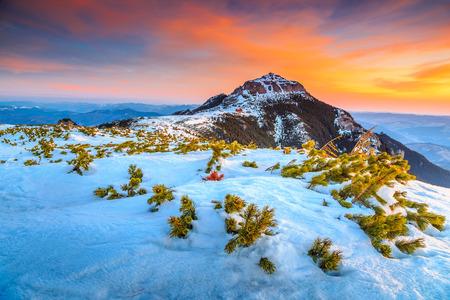 ridges: Beautiful sunrise and snowy ridges on the Ceahlau mountains,Carpathians,Transylvania,Romania,Europe Stock Photo