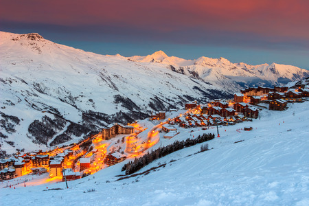 resort: Majestic winter sunrise landscape and ski resort with typical alpine wooden houses in French Alps,Les Menuires,3 Vallees,France,Europe Stock Photo