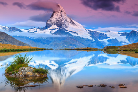 stunning: Stunning sunrise panorama with Matterhorn and beautiful alpine lake,Stellisee,Valais region,Switzerland,Europe Stock Photo