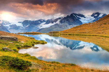 valais: Magical sunset and Stellisee alpine glacier lake with high mountains in background,Valais region,Switzerland,Europe