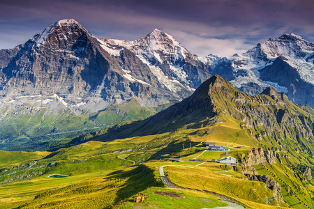 eiger: Stunning alpine panorama with Jungfrau,Monch,Eiger North face and Mannlichen cable car station,Grindelwald,Bernese Oberland,Switzerland,Europe