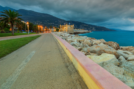azur: Stunning walkway with majestic castle and beautiful lights,Cote d Azur,Menton,France,Europe