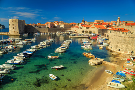 boat house: Dubrovnik fortress panorama and harbor with boats and luxury yachts,Dalmatia,Croatia,Europe