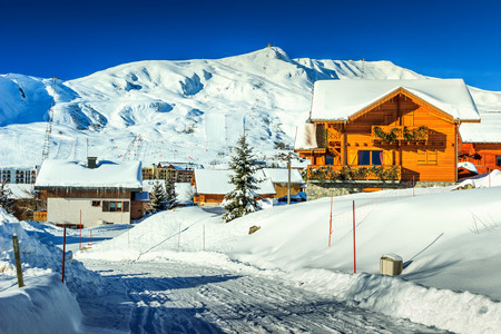 stunning: Stunning winter panorama with snowy road and village,La Toussuire,France,Europe