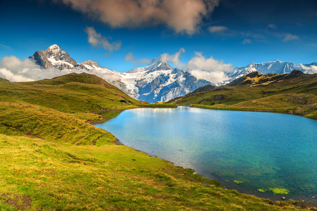 the bernese oberland: Bachalpsee alpine lake with high mountains and snowy peaks in background,Grindelwald,Bernese Oberland,Switzerland,Europe