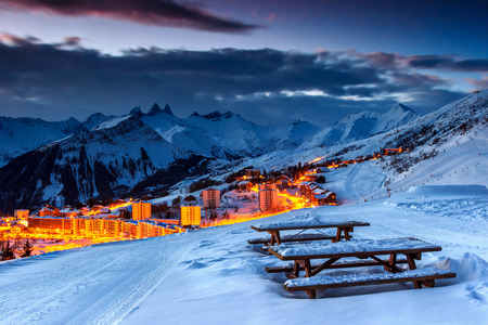 rock: Majestic winter sunrise landscape and ski resort with resting place in French Alps,La Toussuire,France,Europe