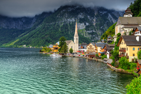 temple tower: Fabulous alpine village with majestic lake on cloudy day,Hallstatt,Salzkammergut,Austria,Europe
