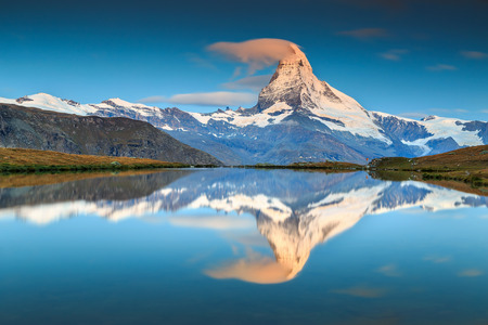 Stunning sunrise panorama with Matterhorn and beautiful alpine lake,Stellisee,Valais region,Switzerland,Europe Standard-Bild