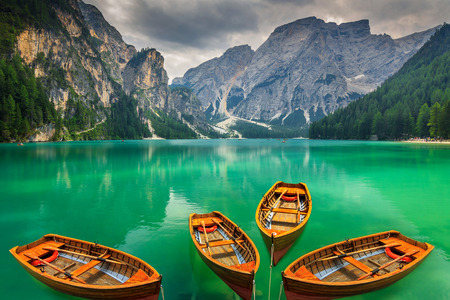 Stunning romantic place with typical wooden boats on the alpine lake,(Lago di Braies) Braies lake