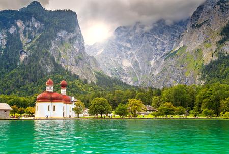 Beautiful fabulous alpine glacier lake Konigsee with stunning St Bartholoma church