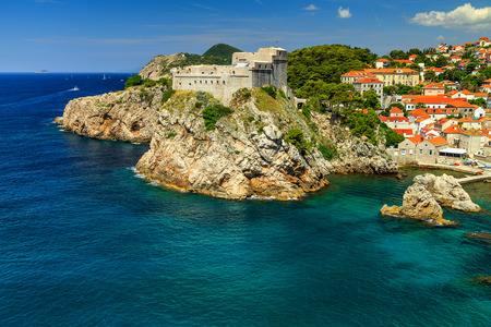 mediterranean houses: Traditional Mediterranean houses with red tiled roofs and rocky coastline,Dubrovnik,Dalmatia,Croatia,Europe Stock Photo
