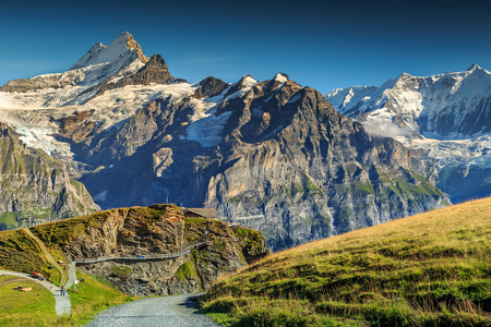the bernese oberland: First named mountain station with Cliff Walk and Schreckhorn peak in background,Bernese Oberland,Switzerland,Europe Stock Photo