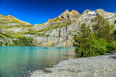 the bernese oberland: Stunning alpine lake and beautiful mountains with glaciers and green forest,Oeschinen lake,Bernese Oberland,Switzerland,Europe