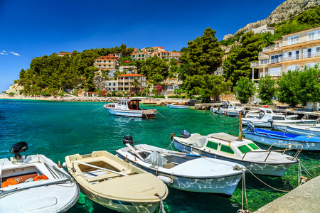 mediterranean houses: Typical mediterranean houses and fishing harbor with motorboats,Makarska riviera,Brela,Dalmatia,Croatia,Europe Stock Photo