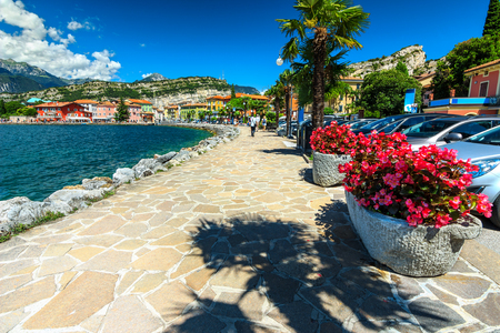 garda: Stunning cityscape and walkway on the shore,Lake Garda,Torbole,Italy,Europe