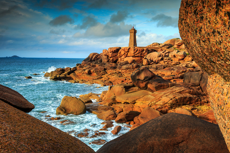 ploumanach: Spectacular sunset with lighthouse of Ploumanach Mean Ruz in Perros-Guirec on Pink Granite Coast,Brittany,France,Europe