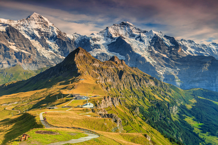 monch: Stunning alpine panorama with Jungfrau,Monch,Eiger North face and Mannlichen cable car station,Grindelwald,Bernese Oberland,Switzerland,Europe
