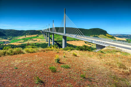 millau: Best locations of world,spectacular viaduct of Millau with agriculture fields,Aveyron region,France,Europe Stock Photo