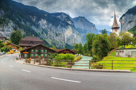 the bernese oberland: Famous stunning touristic town with high cliffs in background,Lauterbrunnen,Bernese Oberland,Switzerland,Europe