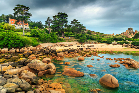 ploumanac'h: Stunning rocky beach with pink granite stones and wonderful green gardens on the coast,Ploumanach,Perros-Guirec,Pink Granite Coast,Brittany,France,Europe