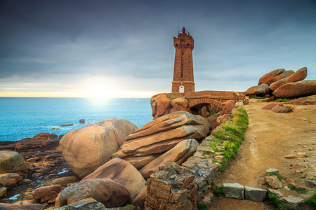 ploumanach: Stunning sunset with lighthouse of Ploumanach Mean Ruz in Perros-Guirec on Pink Granite Coast,Brittany,France,Europe