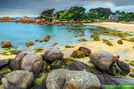 ploumanach: Spectacular rocky beach with pink granite stones and wonderful green gardens on the coast,Ploumanach,Perros-Guirec,Pink Granite Coast,Brittany,France,Europe Stock Photo