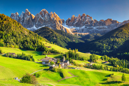 Famous best alpine place of the world, Santa Maddalena village with magical Dolomites mountains in background, Val di Funes valley, Trentino Alto Adige region, Italy, Europe Stock Photo - 70750402
