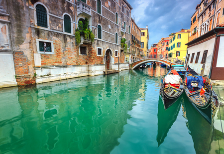 romantic places:  Colorful buildings with bridges and gondolas in the best touristic town, Venice, Veneto region, Italy, Europe