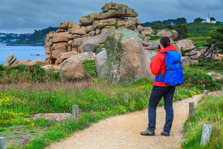 ploumanach: Active young sportive hiker woman in nature, Perros Guirec, Brittany region, France, Europe Stock Photo