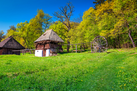 Typical Transylvanian old peasant house and wooden watermill, Astra village museum, Sibiu, Transylvania, Romania, Europe