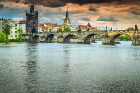 Colorful sunset and spectacular cityscape with old stone Charles bridge in Prague, Czech Republik, Europe Stock Photo