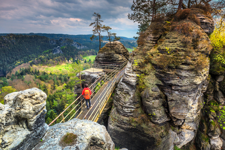 saxon: Amazing hiker trails with interesting high cliffs and green forest near famous Bastei bridge in Germany, Dresden, Saxon Switzerland, Europe Stock Photo