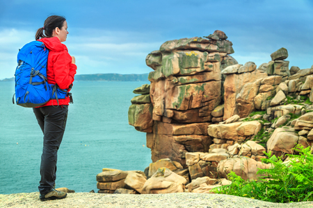 ploumanach: Attractive young sportive hiker woman in nature, Perros Guirec, Brittany region, France, Europe