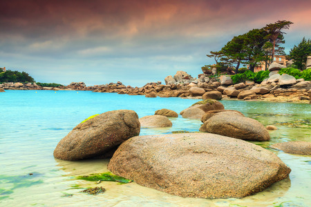 ploumanach: Stunning rocky beach with pink granite stones and wonderful green gardens on the coast, Ploumanach, Perros-Guirec, Pink Granite Coast, Brittany, France, Europe