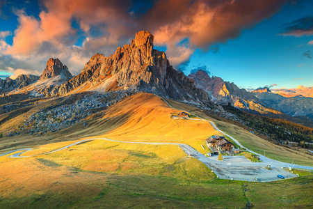 Amazing autumn landscape, alpine pass and high mountains, Passo Giau with famous Ra Gusela, Nuvolau peaks in background, Dolomites, Italy, Europe