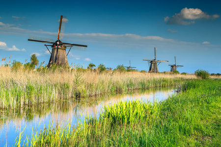 Fabulous water canal in Kinderdijk with traditional old dutch windmills, UNESCO world heritage site, Netherlands, Europe