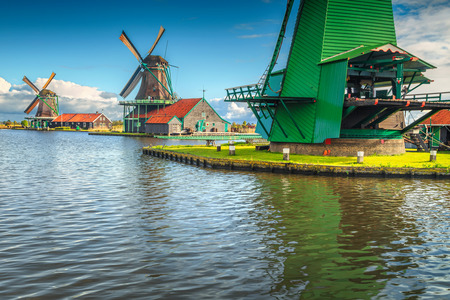 Famous authentic Dutch windmills in Zaanse Schans touristic village and museum near Amsterdam, Zaandam, Netherlands, Europe