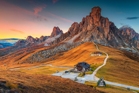 Fantastic sunset landscape, alpine pass and high mountains, Passo Giau with famous Ra Gusela, Nuvolau peaks in background, Dolomites, Italy, Europe Stock Photo