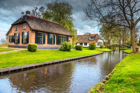 Spring village landscape, stunning traditional dutch village with wooden bridges and water canals, Giethoorn, Netherlands, Europe